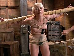Yeah, a cutie like Lexi need to learn how to walk straight and with decency. Well, not really! She needs a little help so the executor tied her arms on a wooden beam and made her walk with a vibrator on her clit. She needs to learn the correct position and maybe it will take a while.