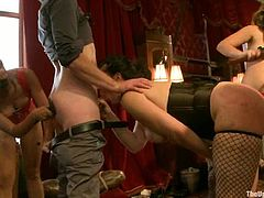 Two hot chicks in stockings and fisted and pinched. Later on they suck big hard cock and tied up. In addition their masters fix clothespins to their bodies.