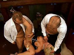 Insatiable blonde bitch Cindy Dollar is having fun with two dudes indoors. SHe sucks and rubs their dicks like never before and then welcomes them in her cunt and asshole.
