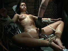 Amazing Black babe lies on a medical chair being tied up in some basement. After that she gets her pussy toyed and tits tortured with clothespins.