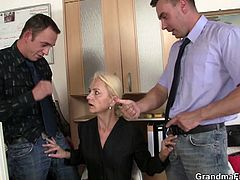 Naughty granny gets two hard cocks at work. Hot daddy and horny son takes advantage of her wet pussy in the office. She didn't want them to get disappointed so she lets them fuck her like crazy.