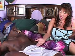 Naughty and with a pair of huge boobs Ava pleasures her black midget. The tiny guy has a rock hard cock, that Ava barely waits to play with. She grabs his penis, licks it and then, puts that black dick between her jugs. Yeah, she does the job right and maybe, she will get some midget cum on her breasts too!