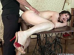 Skanky brunette MILF moans with pleasure while a sophisticated wanker pokes her vagina from behind as she lies on the table. Later he forces her to suck his penis in sultry sex video by 21 Sextury.