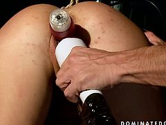 Nasty girl with filthy sex fantasies loves being sexually tortured and humiliated. So she is tied up with her legs spread wide apart. The guy stretches and pins her pussy lips. He also inserts sex machine with dildo head inside her clam.