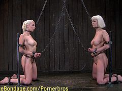 Two buck naked blonde babes are on their knees, chained and unable to move. They're forced to lick each others' pussy and rub their wet snatch against the chain. They enjoy some hardcore whipping and love the pain!
