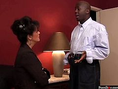 Horn made brunette mature seduces black waiter that brought drinks into her hotel room. She unzips fly and pulls down his pants before she welcomes his sturdy cock inside her mouth for a thorough blowjob in interracial sex video by Pornstar.