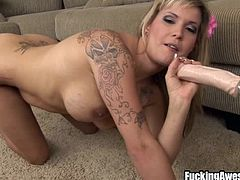 Meet Payton, a blonde slut that feels horny. She's all alone so she takes off her panties and begins to act naughty. The bitch remains only in her high heels and goes down on the floor to play with herself. She uses her dildo, strapped on to a sex machine and sucks it a bit before fucking her snatch with it.