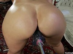 Lewd blonde mom Sara Jay is having fun with a fucking machine indoors. She shows off her hot holes and then gets her pussy double penetrated by the device.