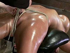 Sexy Mackenzee Pierce Placed in Domination Device for Toying