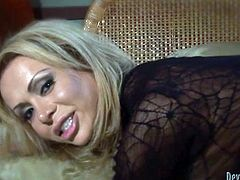 I throw this tranny whore down onto the bed and fuck her, like a crazy slut, that she is. I whip out my big cock, shove it into her asshole and ram her really hard. She takes my cock like a bitch. I bend her over and ass fucks her from behind. Her shemale hole feels so good and tight on my cock.