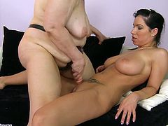 Big breasted brunette sexpot sucks that fake phallus greedily to make it wet. Then she rides it reverse cowgirl style. Make sure you don't miss this hot lesbian sex scene.