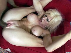 Spoiled nympho is the owner of awesome big boobs and rounded big ass. Hot like hell blondie thirsts for orgasm. So ardent cowgirl spreads legs wide to be fucked missionary by black stud right on the sofa.