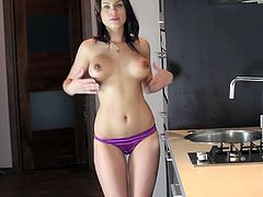 Beautiful dark-haired girl is getting naughty in the kitchen. She strips and demonstrates her nice body and then sits down on the kitchen counter and finger-fucks her juicy snatch.