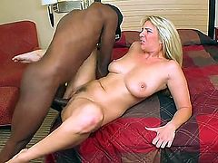 Ebony fellow with monster dong is having delight with his white blonde girlfriend Jordan Kingsley. His chocolate shlong enters her tight twat in a lot of different positions.