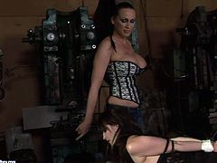Hussy slut is hogtied in doggy position. He hands also tied up behind her back so she is unable to make a single move. She gets toy fucked intensively.