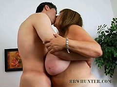 Take a look at the size of this mature BBW's natural breasts in this hot clip where this guy's makes her suck on his hard cock before fucking her.
