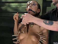Hot brunette babe gets gagged and tortured with clothespins. After that she sucks big dick and gets her wet pussy fucked hard.