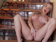 Attractive naked blonde babe Angela Sommers with big firm hooters and long sexy legs in high heels only fingers wet shaved pussy to orgasm on the staircase in point of view.