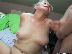 Filthy granny showered with cum as she fervently opens her wet pussy for that young cock. Her charms never fail her to seduce younger lovers that satisfies her cravings.