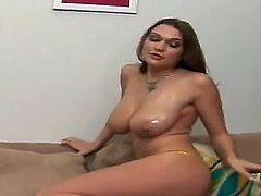 Provocative dark haired amateur babe Cassandra Calogera with round bums in yellow lace thong plays with gigantic natural oiled tits while teasing in close up and stuffs cunny with toy.