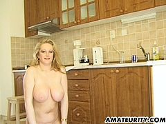 This mature amateur has amazing natural boobs. She gets fucked in the kitchen and her man cums on her jugs.