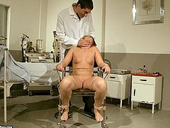 Insatiable harlot is securely tied to a chair. She is weak and ready for any sex tortures. Horny doctor makes her worhsip his rock hard cock and then he clamps some metal clothespins on her patient's swollen nipples.