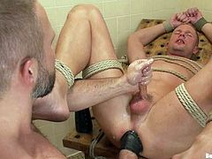 Blake Goodwin and Dirk Caber are playing BDSM games in the locker room. The submissive man shows his ass to his BF and lets him fist and toy it before he rips is apart with his dick.
