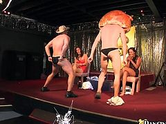 This crazy action in the club is gonna astonish you. Sexy male strippers dance for female public and then the studs offer the hotties to taste their schlongs.