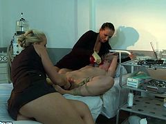 Welcome to see a bondage session right in the madhouse presented in steamy 21 Sextury xxx clip. Brunette and blond dykes in black stuff ties up submissive gal with ropes and polish her wet pussy with a dildo right on the bunk bed.