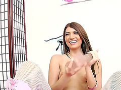 Cassandra Nix is a hot and horny woman in ripped white fishnet pantyhose that is going to have wonderful solo masturbation on camera. She uses dildos and vibrator to do it.