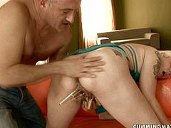 Horny stud gives this slut a check up he'll never forget. He clamps clothespins on her swollen nipples and then stretches her pussy with a vaginal speculum.
