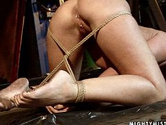 Spoiled blond bombshell gets suspended head down and forced to finger fuck her vagina by insatiable domina. Later she puts her on the floor where she continue giving her bad times by making her suck a thick dildo in BDSM-involved sex video by 21 Sextury.