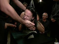 These people paid lots of money to watch this show. This tied up girl gets her pussy drilled with a fucking machine. Later on she also gets fucked by some guys.