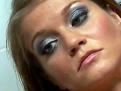 Bosomy slut Rita Faltoyano gets intercepted by two endowed studs in the bathroom and strokes their  fat willies unilt they cover her face with sizzling hot cum.