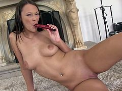 Laura Brook feels intense pleasure when sliding the toys down her fine holes