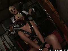 This blondie is a slutty chick with a nice pair of well-matured tits. She is bound hand and foot and completely at the mercy of her horny mistress. Check out this wild BDSM sex video now to see what else these spoiled nymphos are up to.