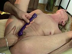Worn out blond mature lies on her back while a kinky dude plays with her ruined cunt using sex toys before fucking it missionary and doggy styles.