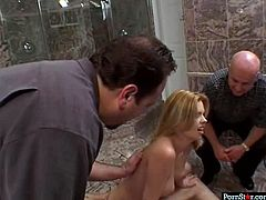 Hot blooded red-haired MILF makes out with kinky dudes in luxurious marble bathroom. She lies on the counter while getting anal fucked before horny daddy cumshots on her face in gangbang sex video by Pornstar.