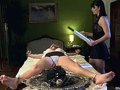 Poor blonde girl gets dominated by nasty Bobbi Starr. She gets her pussy toyed with an electric dildo and then fisted.