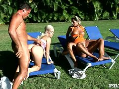 Two nasty blondes Daria Glower and Nesty are having fun with some guys in the garden. The girls please the studs with blowjobs and then they fuck in cowgirl position on the beach chairs.