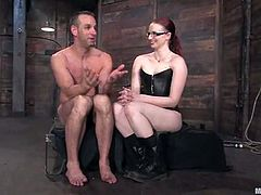 Redhead dominant milf Claire Adams is playing BDSM games with Jason Miller in a basement. She ties him up and then beats his prick with a stick and enjoys the way he moans with pain.