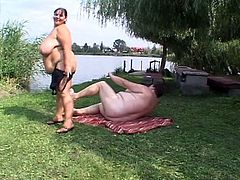 These obese matures go outside in their bathing suits to relax. Soon they start to play with each others monster boobs and go as far as licking and fingering too.