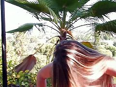 Young brunette cuttie Staci Silverstone with natural perky boobs and long whorish nails has fun while teasing and gets filmed in close up while pissing and smoking in backyard.