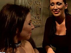 Horn made big lipped brunette mistress hooks up with curvy brunette MILF in black fishnet stockings. She orders her give a head to massive sleek dildo before she uses it to drill her cunt in BDSM-involved sex video by 21 Sextury.