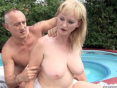 Skanky red-haired mature gets naked in front of aroused daddy before he proceeds to giving her an erotic massage starting from her back and slowly moving to her big quaggy tits.