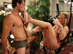 Simone Sonay strips the clothes off and gets her feet licked by Tyler Nixon. Then she get fucked deep in her juicy vagina. After that she makes a guy cum with her sexy feet.
