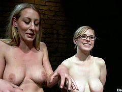 Two blondes with natural tits are dominated in this lesbian bondage video with toying for both as they have gag balls in their mouths.