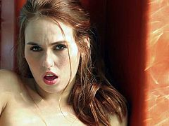 Kiki Vidis is a beautiful red-haired temptress that shows off her body and masturbates in the bathroom. Seductress with sexy natural boobs rubs her pink pussy with her long legs apart.