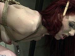 This dude knows how to make punishment effective. He binds her slave in ropes and spanks her gorgeous butt with wooden paddles until it turns scarlet red.