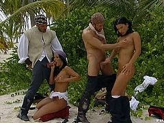 Gorgeous brunettes Nikky Rider and Simonne Style and their men are playing a role-play game on a beach. They all wear pirate costumes and have awesome oral and anal sex.